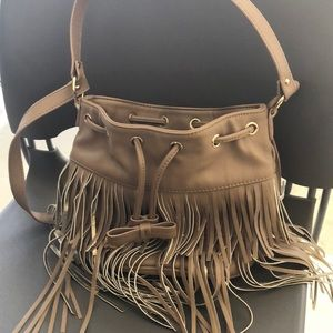 Tan betsey Johnson bucket purse with fringe